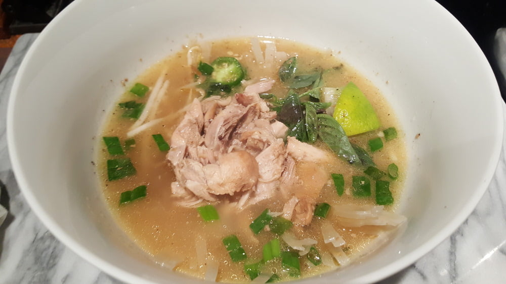 Instant Pot Vietnamese Chicken Pho add broth to bowl